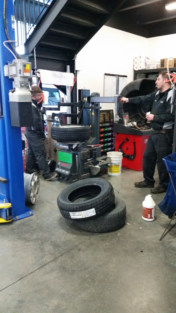 Richard and Klayton mounting the new tires.